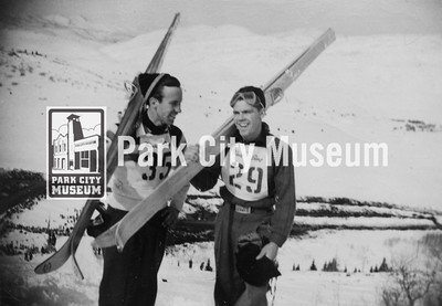 Gordon Despain (#35) and Mel Fletcher (#29) at Ecker Hill ski jump, ca.1940s (Image: 2011-43-14, John Spendlove Collection)