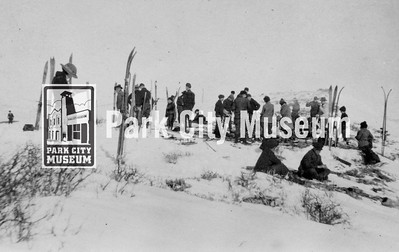"After their lunch break on their adventurous skiing, sledding and hiking trip, a note on the original copy of this picture states that ""everyone [was] feeling fine,"" ca.1922 (Image: digi-5-19, Emmett Wright Collection)"
