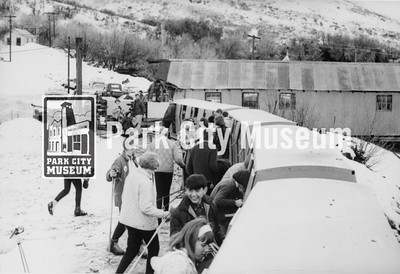 """Boarding the """"Skier Subway,"""" a mine train that took skiers four miles into the mountain to an old mine cage lift which took them to the surface, the top of a run, ca.1965-1969 (Image: 1995-6-1, Park City Ski Area Collection)"""