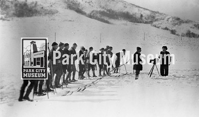 A Twentieth Century Fox newsreel photographer captures moving images of skiers at Rasmussen Hill, ca.1938 (Image: 1986-14-15, Selma Kilby Collection)