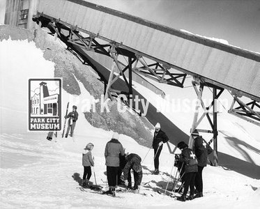 Skiers pause on the slopes beneath an old ore shaft, ca.1960s-1970s (Image ID: 2004-84-1-21-10, Park City Mountain Resort Collection)
