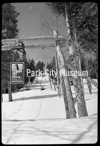 """""""Keep Your Ski Tips Up"""" notice on the chair lift at Snow Park (now Deer Valley), ca.1950s (Image: 2000-17-M-128-1, Kendall Webb Collection)"""