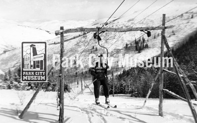 Riding the J-bar at Snow Park, ca.1946-1950 (Image: 2011-43-4, John Spendlove Collection)