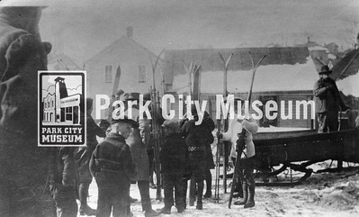 A large group of people wait by sleds for a ride to a ski jump location, ca.1922 (Image: 1999-4-102, Park City Mountain Resort Collection)