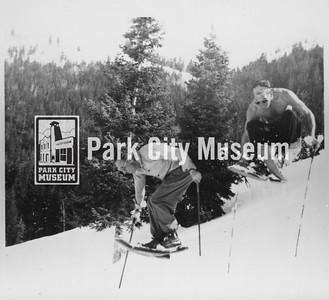 "Early ""hot-doggers"" Les Roach and Mel Fletcher on barrel staves, skiing Burns Alley at Snow Park (now Deer Valley), ca.1953-1954 (Image: 1986-3-3, Mel Fletcher Collection)"