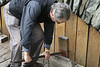 A worker would raise a wooden gate to allow water--weighing 62.4 pounds per cubic foot--to pour into the wheel.