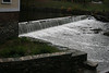 A dam on the Blackstone River provided power. The weight of water would drive the mill.