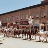 "The 20-mule train led by Gene DeHaven was routed through downtown Spearfish, allowing local folks to witness a part of the 1,200 mile trek made by DeHaven and his crew in the summer of 1966.  <center>Return to:  <a href=""http://www.spearfishhistory.org"">Spearfish History</a></center>"
