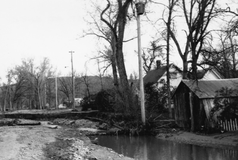 Linda Rothermel of Belle Fourche advises that this photo was taken in the vicinity of  the 400 block of 3rd Street.   May 1965 flood - Spearfish, SD.