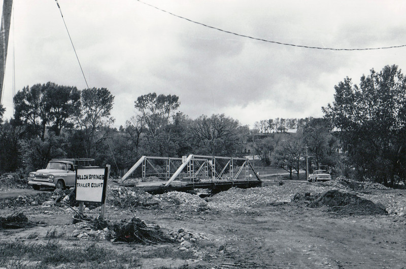 This appears to be the Grant Street bridge, looking southwest toward the vicinity of the Passion Play.   May 1965 flood - Spearfish, SD.
