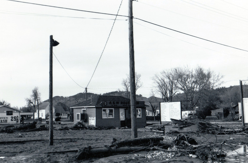 Debris surrounds the A & W Drive-Inn.  May 1965 flood - Spearfish, SD.