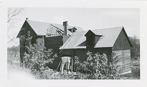 "Linfred noted that at one time, there were three flour mills in Spearfish.  This 1939 photograph shows the ""south side of Spearfish flour mill.  The old tramway took the wheat in an open door at top wheat bin.  Sacks of wheat were unloaded from wagons into a small car holding 15 sacks and pushed into top of bin and wheat was then unloaded.""  A veryslow proces.  Photo and information is courtesy of the South Dakota State HIstorical Society."