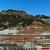 Panoramic view of Lookout Mountain seen from Rose Hill Cemetery.  Interstate 90 can be seen stretching across the terrain in front of the mountain.  This shows the strip of I-90 between Exit 12 (to the left) and Exit 14 (to the right).