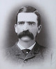 "For all of his many endeavors, Seth Bullock identified himself as a ""Miner"" in the 1890 Deadwood City Directory.  <br /> <br /> He and Star had invested in several mining ventures, particularly the Iron Hill Mine.  He had been a director since 1883 and was listed as its President by 1885.  During a seven-year period, the mine reportedly produced $725,000 in silver bullion.   Nonetheless, steep expenses left Bullock netting only about $600 during that entire time.  As characterized by Woll in his presentation, Bullock ""lost his shirt on the Iron Hill Mine.""<br /> <br /> The 20th century held new directions for Bullock, as he entered what Wolff calls his ""public service era.""  Bullock's long-standing friendship with President Theodore Roosevelt resulted in -- among other things -- Bullock's appointment as supervisor of the Black Hills Reserve, a Colonel with TR's ""Rough Riders,"" and an appointment as U. S. Marshall for South Dakota.<br /> <br /> Thanks to the Adams Museum and House for use of this photo."