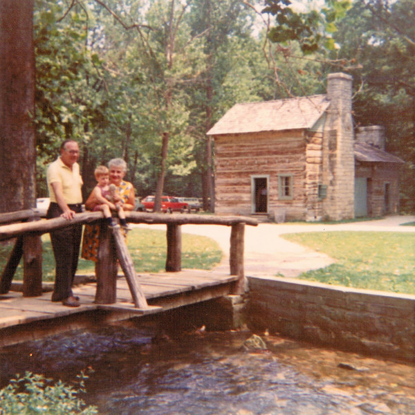 """Spring Mill State Park Pioneer Village - 1970<br /> <br /> This is an old family photo of me at Spring Mill with my grandma and grandpa (my mom's parents) when I was a little over two years old. The Sheek's house is seen in the background (I have a shot of this house as it stands in 2010 towards the end of this gallery).<br /> <br /> <br /> <a href=""""http://www.in.gov/dnr/parklake/2968.htm"""">http://www.in.gov/dnr/parklake/2968.htm</a><br /> <br /> <a href=""""http://en.wikipedia.org/wiki/Spring_Mill_State_Park"""">http://en.wikipedia.org/wiki/Spring_Mill_State_Park</a>"""