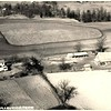 2a2.  1.2 mb scan of one of J.E. McCulley's photo's of the family farm. In the upper right corner of the field being plowed is J.E. on the tractor.  From the looks of the car parked behind the house, it looks to be a mid-1950s picture. J.E. and June's house has not yet been built in the woods lot in the upper left corner of the picture. I think it was built about 1960. The little white house in the corner is at the corner of Mt Tabor and Old Glory. The houses on the upper right corner are on the west side of Old Glory Road.