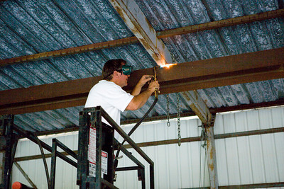 Joe torching the welds that once held our bracing!
