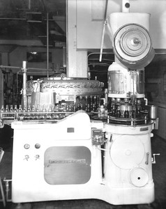 Machines filling and capping bottles at the Coca Cola Bottling plant in 1948. Photograph courtesy of State Archives of Florida, Florida Memory, http://floridamemory.com/items/show/51589