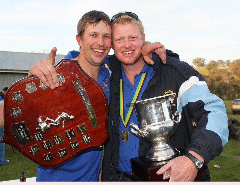Michael holding the George Tooke Shield with Benny Grange and the Minor Premiership Cup at Kuriong after The Brahman's Grand Final victory in 2010.