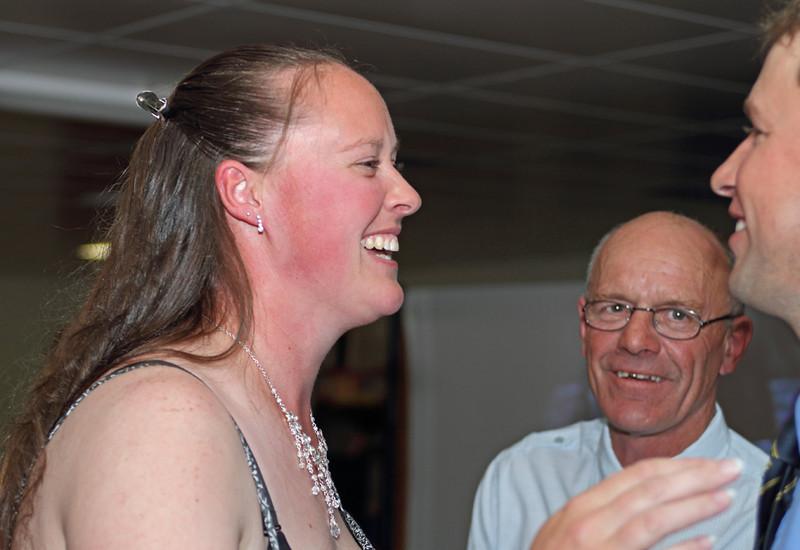A flushed Brahmans Secretary Madaline Brayshaw with Jack Lee and husband Michael on presentation night.
