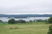 PHOTO RECEIVED JUNE 25 2004 ÎLE SAINTE-CROIX, as seen from Bayside, Nouveau-Brunswick. TAKEN DURING THE CELEBRATIONS OF THE 400 ANNIVERSARY OF THE ARRIVAL OF FIRST ACADIANS IN ACADIE.