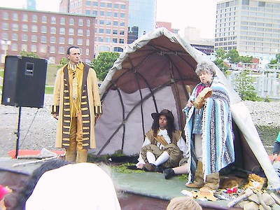 CHKOUDUN (Maliseet Chief) HAS ARRIVED TO HIS VILLAGE AND IS INTRODUCING HIS VISITORS TO THE SWEETGRASS CEREMONY ALSO CALLED SMUDGING. (It brings on the spirit of goodwill, health, posperity and long life)