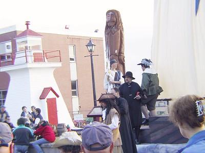 SAMUEL DE CHAMPLAIN & PIERRE DE GUA DE MONT ARRIVAL IN ACADIE STANDING NEAR THE WOOD SCULPTURED STATUES OF CHAMPLAIN & FRANÇOISE-MARIE JACQUELIN (WIFE OF CHARLES DE SAINT-ÉTIENNE DE LA TOUR) (base of king squares in SAINT JOHN NB CANADA)