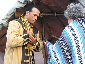 CHKOUDUN (Maliseet Chief) HAS ARRIVED TO HIS VILLAGE AND IS INTRODUCING HIS VISITORS TO THE SWEETGRASS CEREMONY ALSO CALLED SMUDGING(It brings on the spirit of goodwill, health, posperity and long life) (CL)