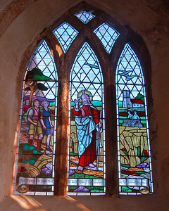 Unique stained glass, commemorating the importance of the church to walkers and cyclists who regularly visit