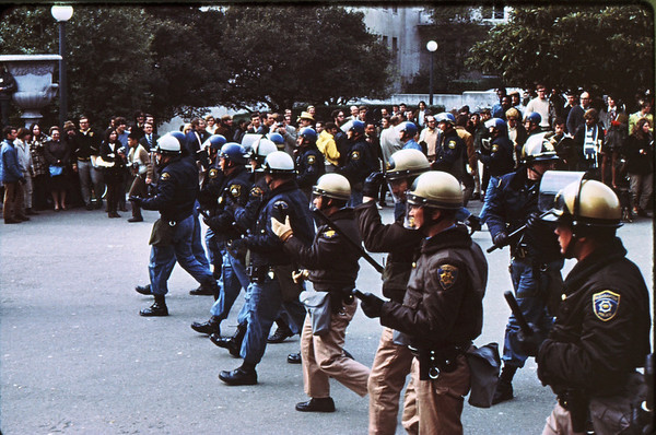 5*Thu, Jan 30, 1969<br /> *People: cops, V<br /> Subject: <br /> *Place: sather gate<br /> Activity: twlf<br /> Comments: cops trying to provoke