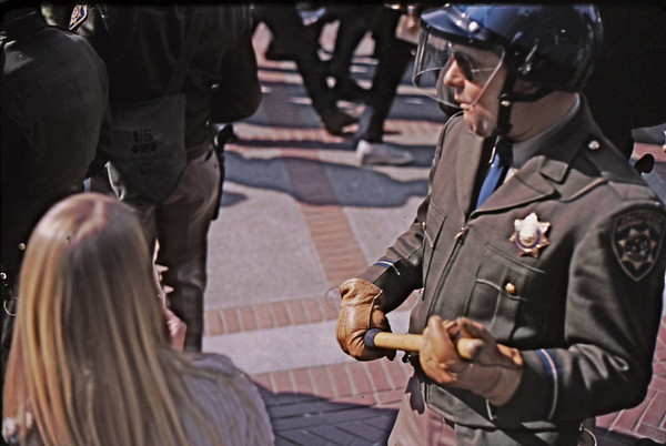 4*Thu, Feb 13, 1969<br /> *People: woman, cop<br /> Subject: blowing bubbles<br /> *Place: sather<br /> Activity: twlf<br /> Comments: facial expresion, hold on baton