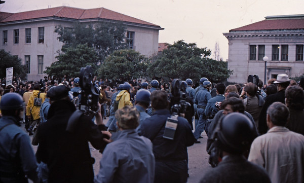 4*Wed, Feb 19, 1969<br /> *People: cops attacking crowd<br /> Subject: <br /> *Place: N of Sather Gate<br /> Activity: twlf<br /> Comments: 3 TV cameras