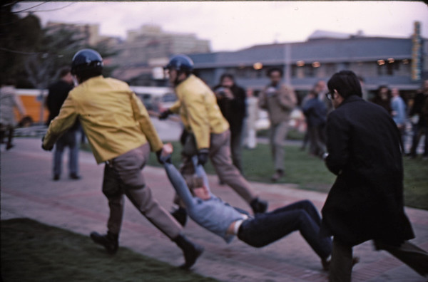 4*Wed, Feb 19, 1969<br /> *People: 2 cops, photogs<br /> Subject: dragging <br /> *Place: near sproul<br /> Activity: twlf<br /> Comments: press getting name