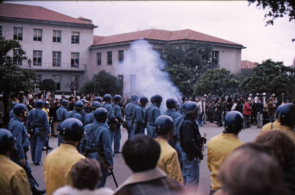 4*Wed, Feb 19, 1969<br /> *People: cops<br /> Subject: smoke bomb, or a tear gas canister thrown back<br /> *Place: northside of Sather Gate<br /> Activity: twlf<br /> Comments: just after another cop attack