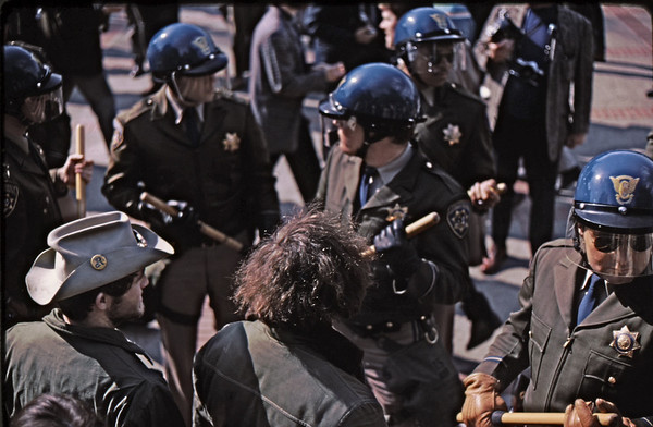 5*Thu, Feb 13, 1969<br /> *People: 2 guys, 5 cops<br /> Subject: <br /> *Place: near Sather<br /> Activity: TWLF<br /> Comments: 5 batons