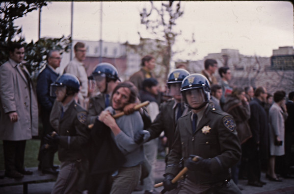 5*Wed, Feb 19, 1969<br /> *People: 4 cops, protester<br /> Subject: protester in choke hold<br /> *Place: sproul<br /> Activity: twlf<br /> Comments: 2 cops looking right at me, university administrators watching