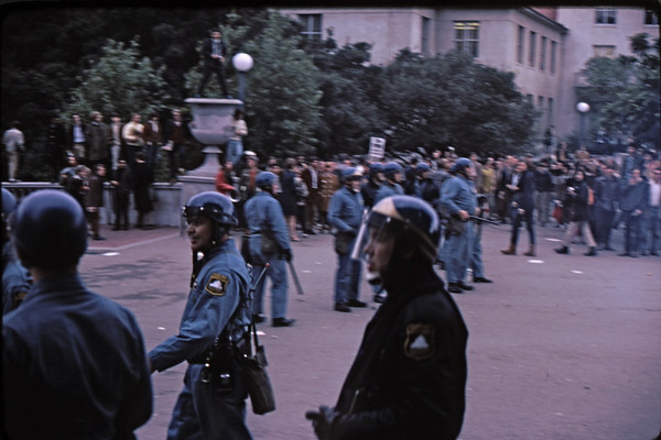 3*Wed, Feb 19, 1969<br /> *People: cops, spectators<br /> Subject: face off<br /> *Place: northside of Sather Gate<br /> Activity: <br /> Comments: shaky, you would be too. Those tear gas canisters explode and make noise.
