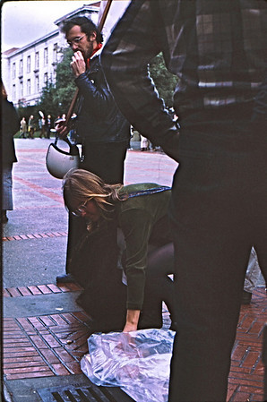 3*Fri, Feb 28, 1969<br /> *People: 3 AFT picketers<br /> Subject: <br /> *Place: sproul plaza<br /> Activity: taking bread<br /> Comments: see the picket line in background.  TWLF protest