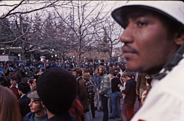 4*Thu, Feb 13, 1969<br /> *People: medic, crowd, cop line<br /> Subject: <br /> *Place: sproul plaza<br /> Activity: twlf<br /> Comments: afro hair