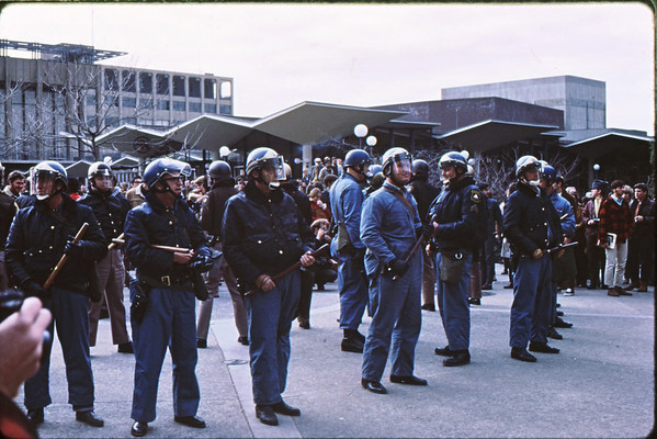 5*Thu, Jan 30, 1969<br /> *People: Blue Meanies cops - Alameda County Sheriffs<br /> Subject: battons - not only<br /> *Place: sproul plaza<br /> Activity: <br /> Comments: facial expression of blue meanie in middle.