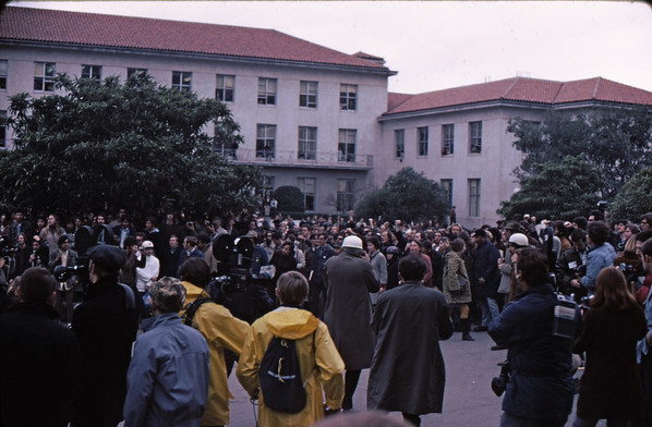 3*Wed, Feb 19, 1969<br /> *People: crowd<br /> Subject: yelling<br /> *Place: northside of Sather Gate<br /> Activity: twlf<br /> Comments: much press, with me not far behind.  I guess I used the press as a buffer.