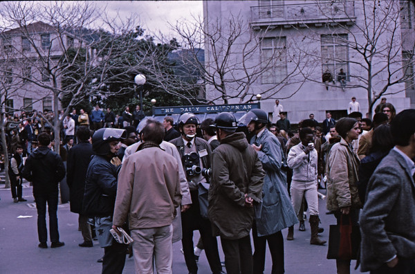 5*Fri, Feb 21, 1969<br /> *People: media photographers in helmets<br /> Subject: <br /> *Place: sproul plaza<br /> Activity: twlf<br /> Comments: 2 days after confrontation