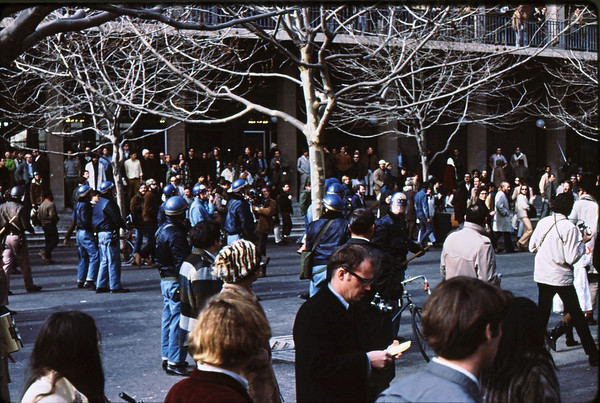 4*Thu, Jan 30, 1969<br /> *People: cops, crowd<br /> Subject: <br /> *Place: by student union, Sproul Plaza<br /> Activity: TWLF protest<br /> Comments: notice batton wielder turned around.  News photogs