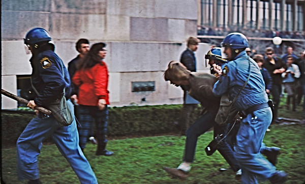 4*Wed, Feb 19, 1969<br /> *People: cops dragging protestor<br /> Subject: <br /> *Place: sproul hall<br /> Activity: twlf<br /> Comments: arrestees taken into Sproul Hall basement for booking.