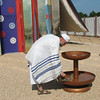 Tabernacle priest re-enactor demonstrates the wash basin for ceremonial washing prior to service.