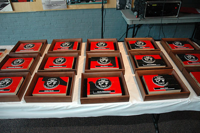 The orginal floor of Heights was used to make these plaques for each of the 1977 boys team members.