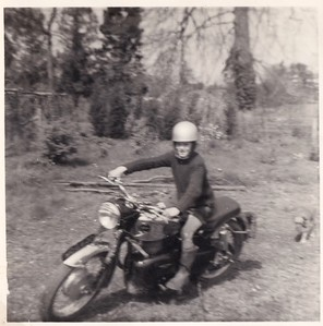 Ian pretends to ride John Fowles's Velocette M/C at the Kings Shoot.