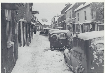 On Church St the mail vans park up in the snow