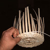 Splints are bent upward and Weese starts weaving the sides of the basket.