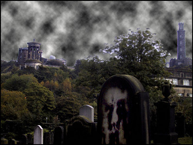 City of the Dead Edinburgh, Scotland.   I did not add the face on the tombstone in the foreground.  It showed up in the image.